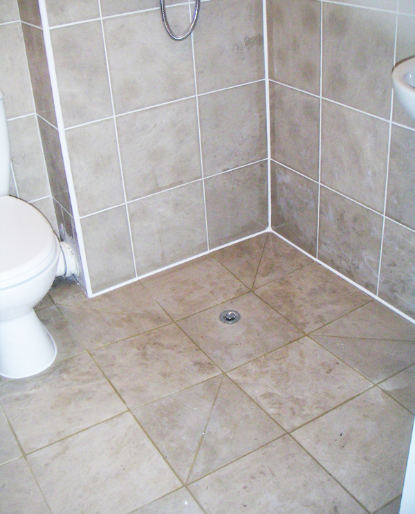 Apollo design wet room installations and bathroom design for Shower room flooring ideas